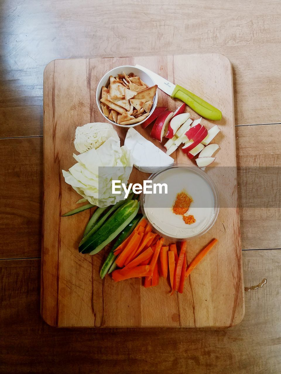 freshness, food and drink, high angle view, cutting board, still life, food, wood - material, indoors, directly above, table, no people, vegetable, healthy eating, ready-to-eat, dip, day