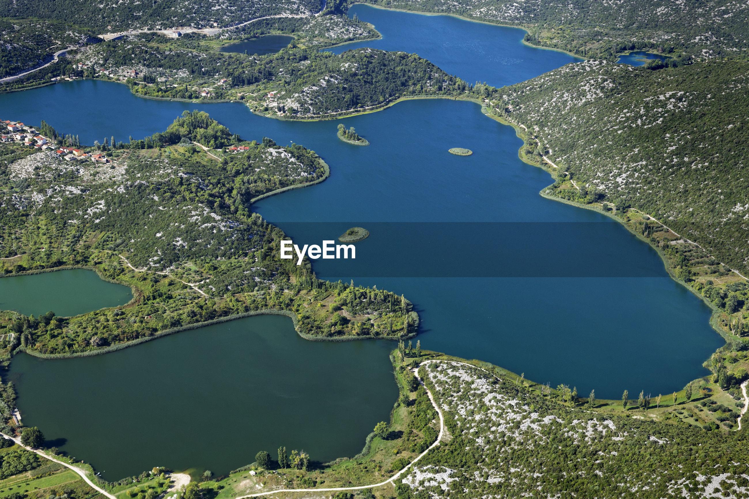 High angle view of lake amidst land