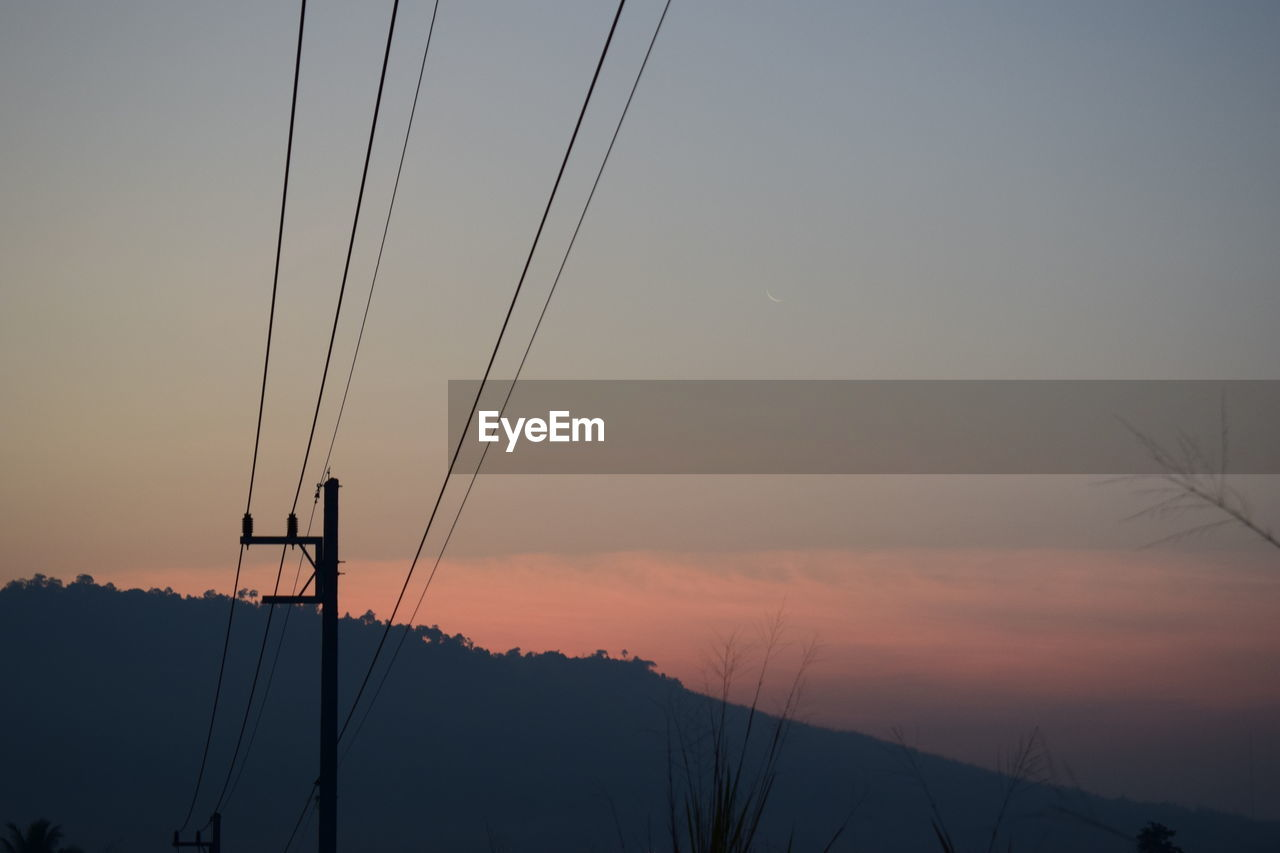 sky, sunset, cable, electricity, orange color, beauty in nature, silhouette, connection, power line, tranquility, nature, no people, technology, fuel and power generation, scenics - nature, electricity pylon, power supply, tranquil scene, dusk, outdoors