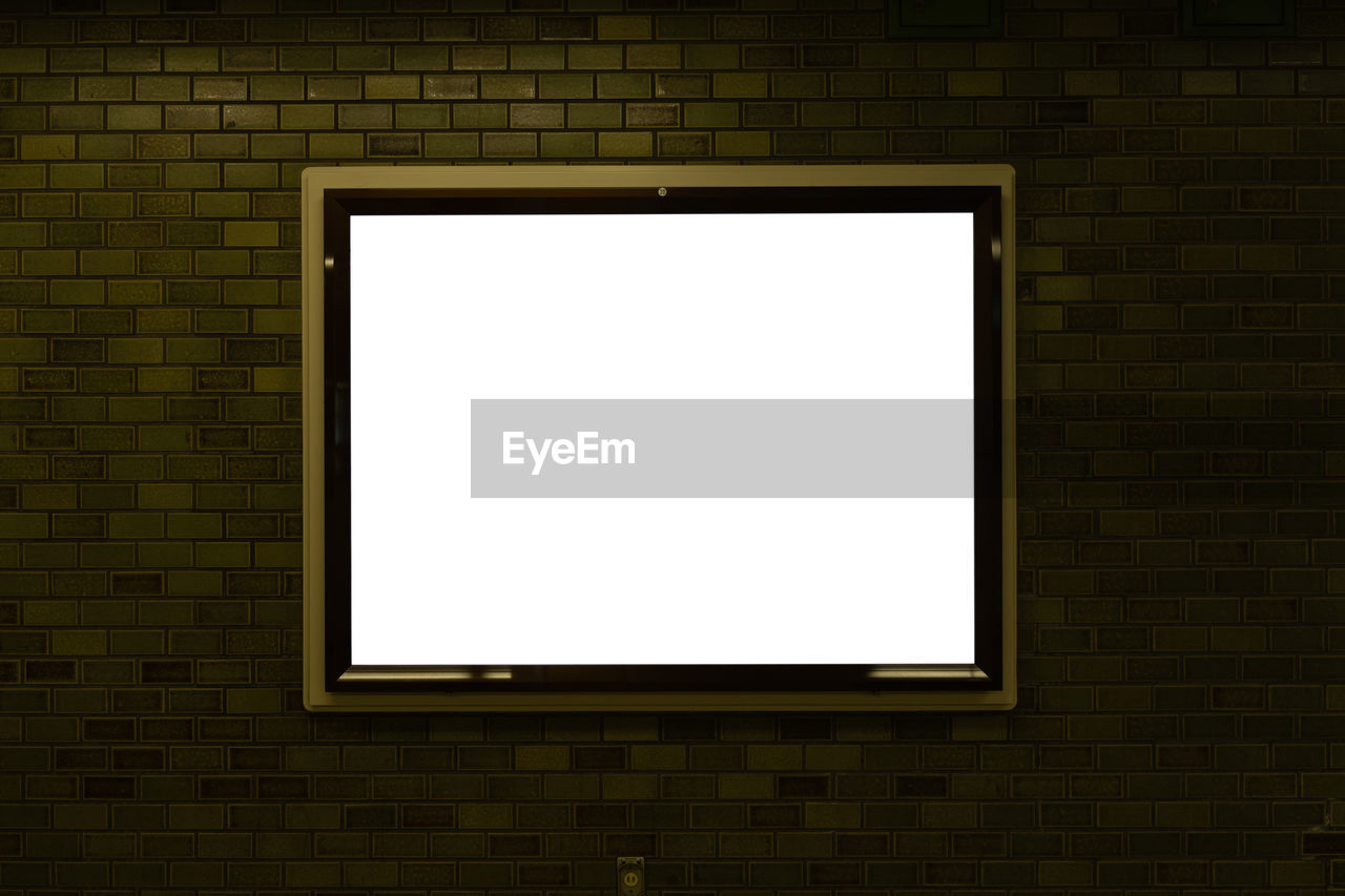 brick wall, brick, wall, blank, wall - building feature, copy space, architecture, no people, picture frame, frame, built structure, window, white color, rectangle, technology, billboard, building, outdoors, geometric shape, message