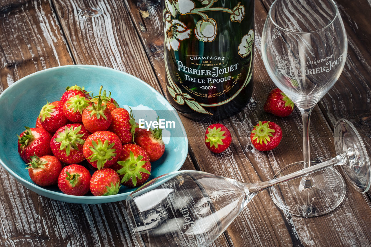 food and drink, food, fruit, healthy eating, freshness, berry fruit, table, glass, wellbeing, strawberry, household equipment, drinking glass, bowl, wood - material, red, kitchen utensil, refreshment, no people, eating utensil, drink, ripe