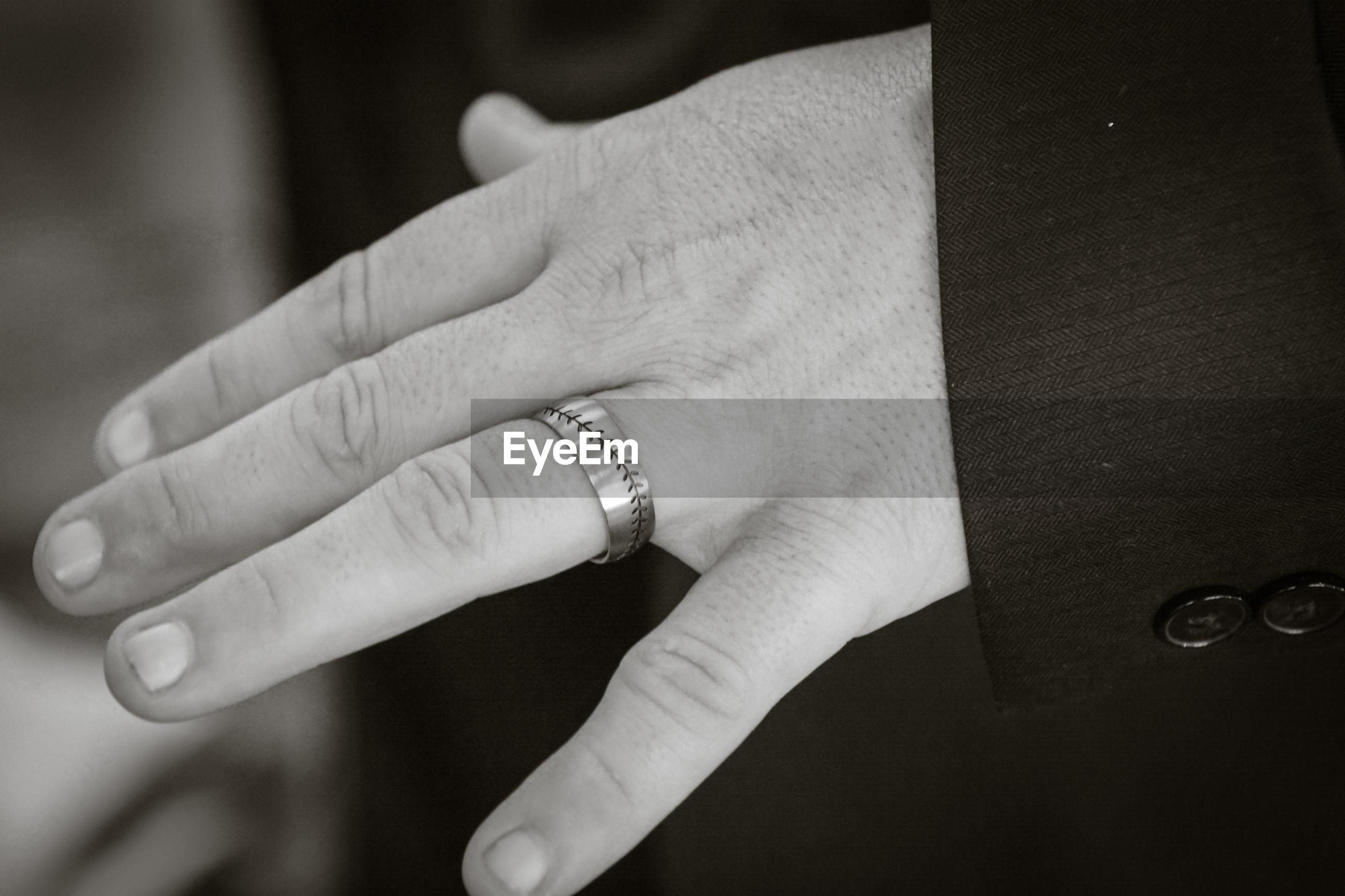Cropped hand of man wearing ring
