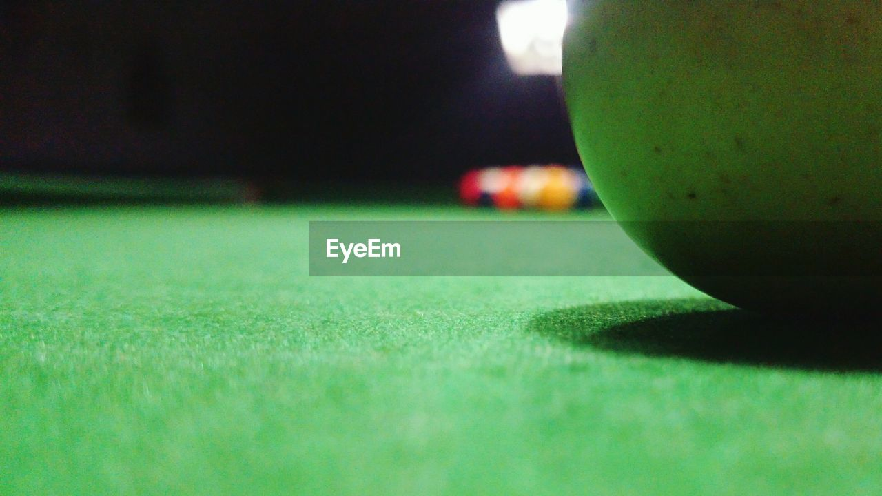 green color, indoors, fruit, sport, selective focus, pool table, close-up, table, pool ball, no people, food and drink, snooker ball, healthy eating, snooker, freshness, food, day, pool - cue sport