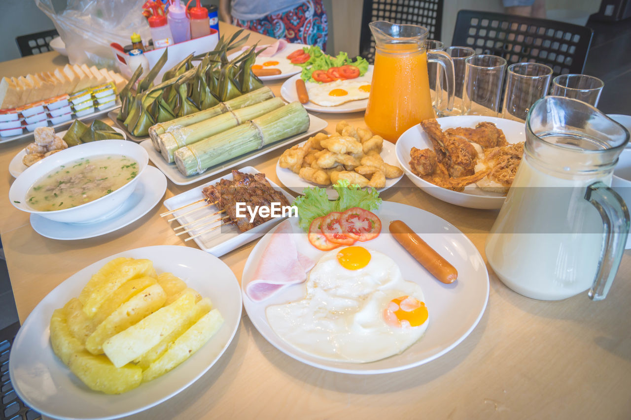 food and drink, food, egg, healthy eating, plate, table, freshness, ready-to-eat, breakfast, indoors, bowl, meat, vegetable, meal, drink, variation, drinking glass, no people, egg yolk, orange juice, close-up, day