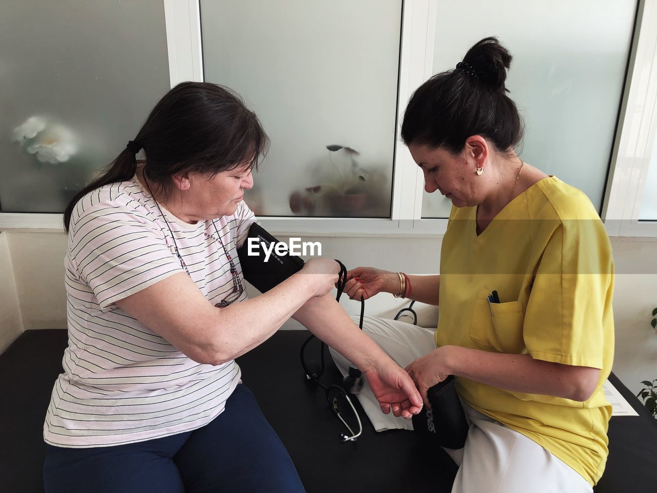Doctor Examining Patient At Clinic