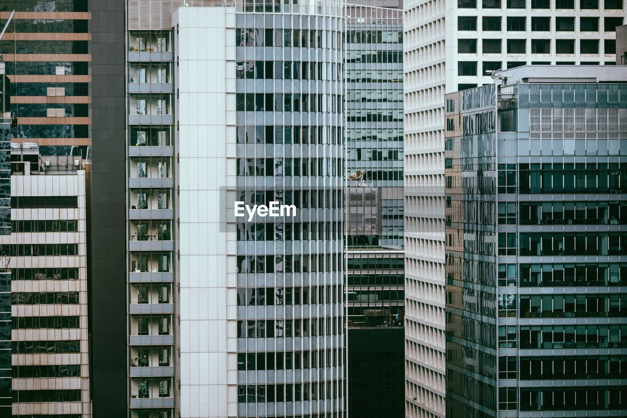 building exterior, architecture, built structure, building, city, window, no people, residential district, office building exterior, full frame, day, modern, outdoors, skyscraper, office, backgrounds, pattern, in a row, apartment, glass - material, financial district