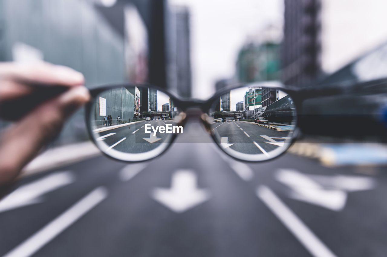 City Street Seen Through Eyeglasses