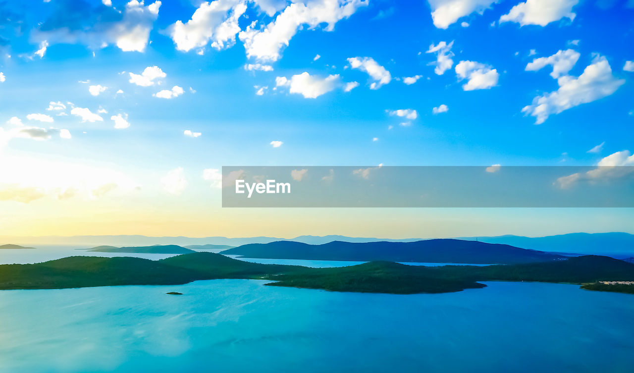 beauty in nature, scenics, water, sky, tranquility, nature, tranquil scene, mountain, cloud - sky, outdoors, no people, blue, mountain range, sunset, lake, day
