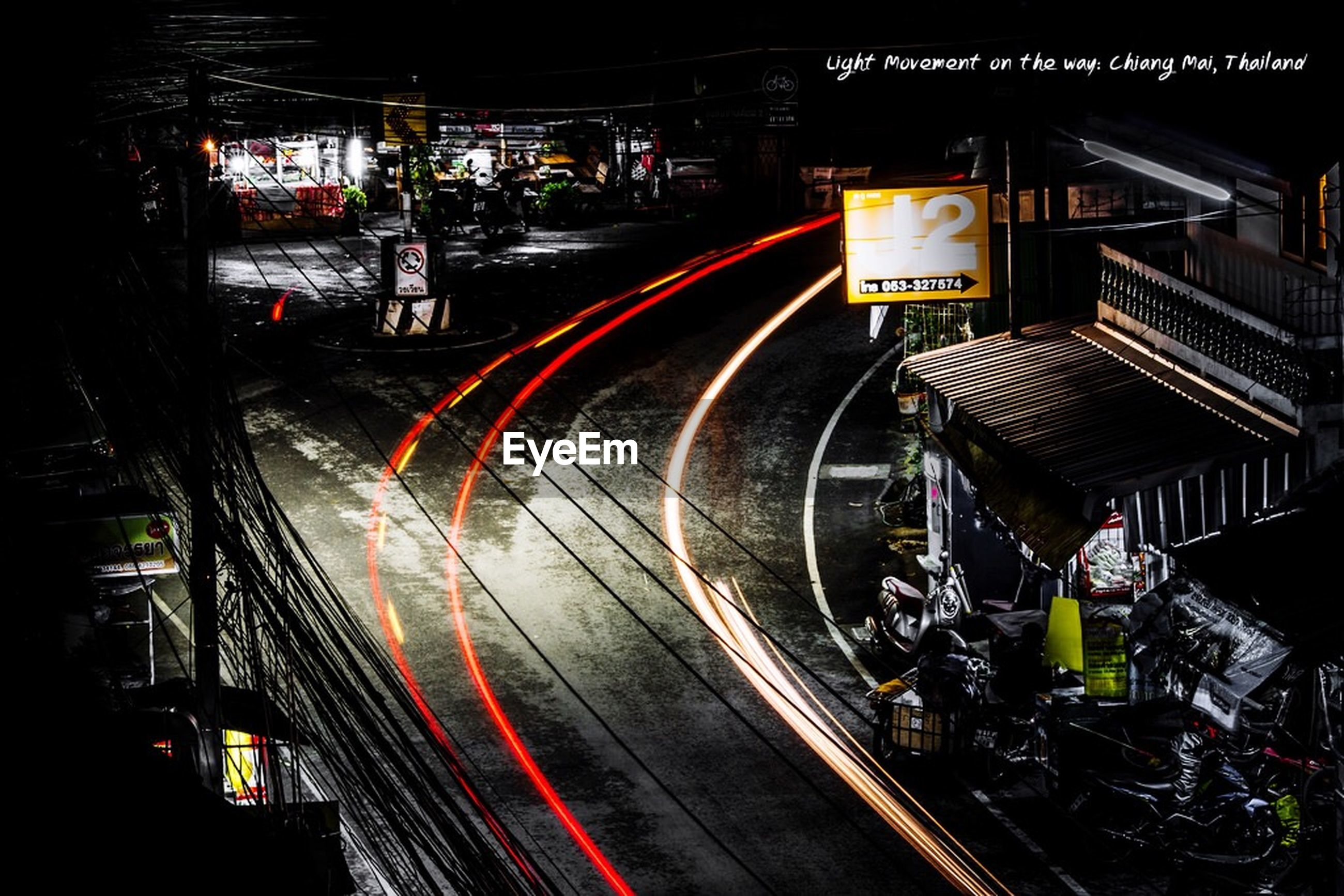 illuminated, night, transportation, long exposure, light trail, speed, railroad track, motion, blurred motion, public transportation, high angle view, city, rail transportation, red, lighting equipment, city life, traffic, mode of transport, built structure, road