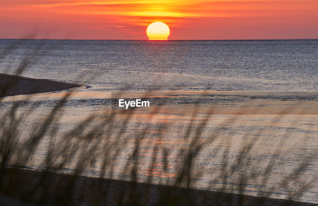 sunset, sky, sea, horizon over water, water, beauty in nature, sun, scenics - nature, horizon, tranquil scene, nature, orange color, tranquility, sunlight, cloud - sky, idyllic, no people, land, beach, outdoors