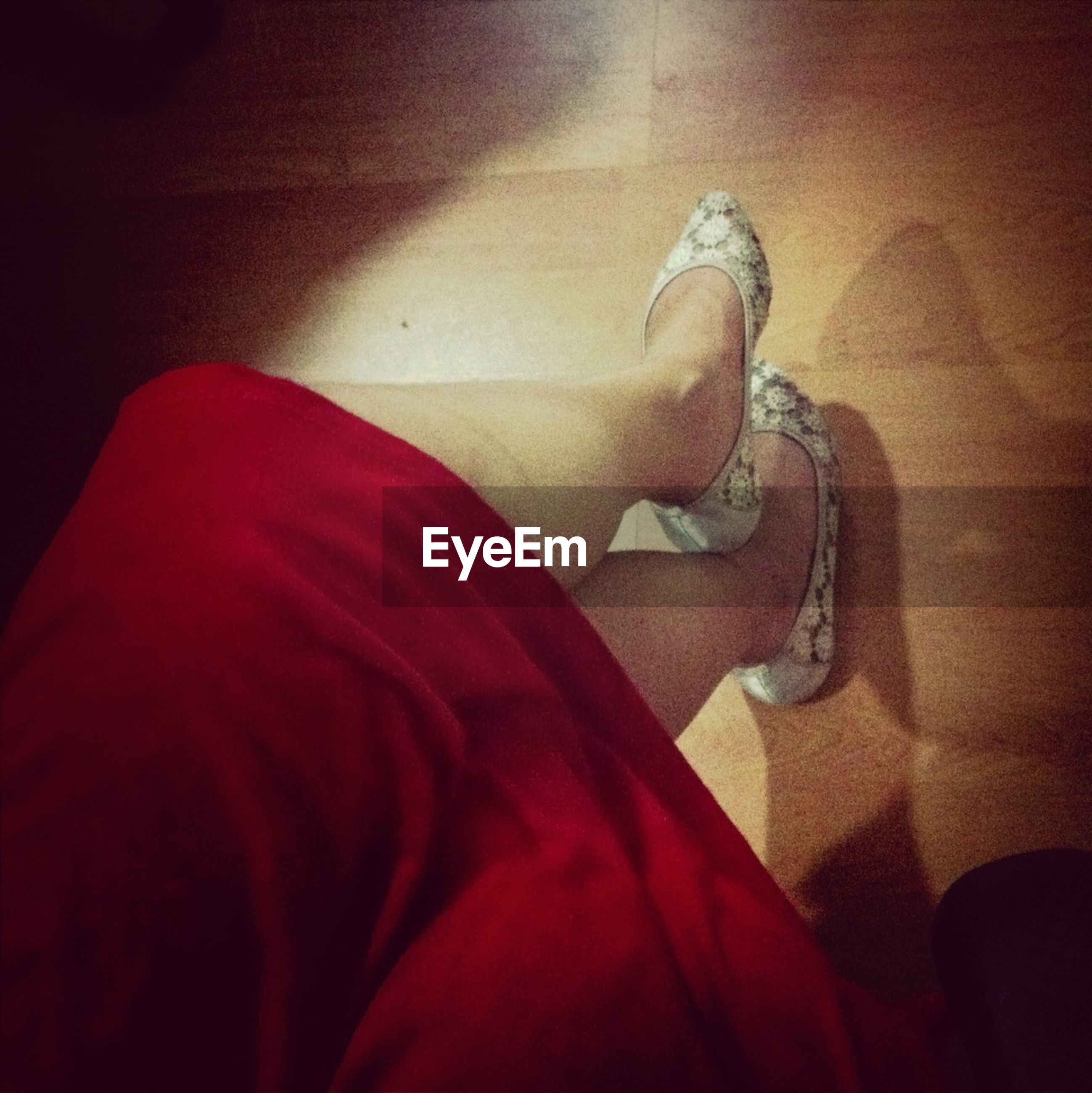 indoors, red, wall - building feature, high angle view, shadow, home interior, close-up, sunlight, wall, day, flooring, shoe, low section, person, part of, steps, sitting
