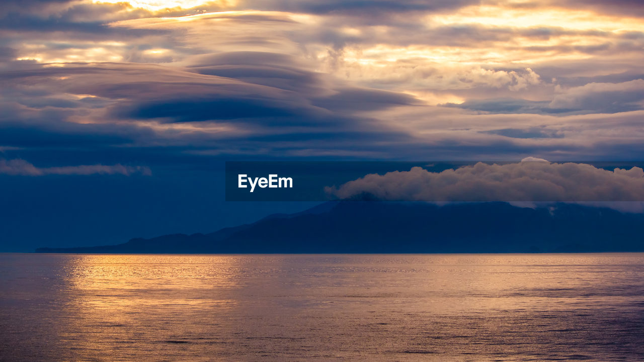 cloud - sky, sky, beauty in nature, scenics - nature, tranquility, tranquil scene, water, sunset, mountain, sea, waterfront, idyllic, no people, nature, non-urban scene, dramatic sky, outdoors, remote