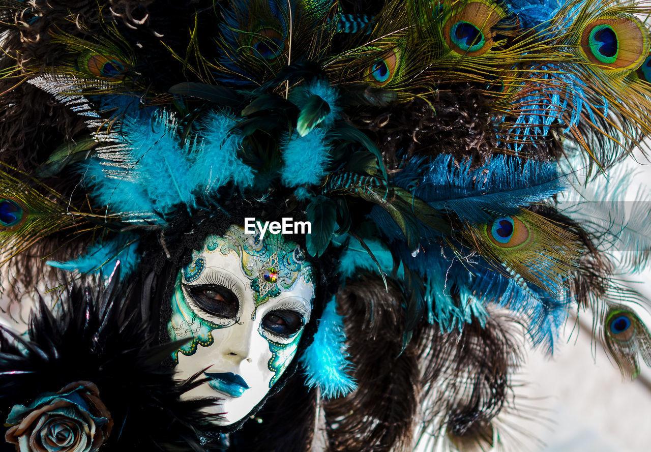 Close-Up Portrait Of Woman Wearing Venetian Mask