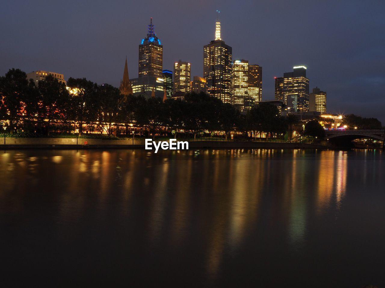 River In Illuminated City At Night