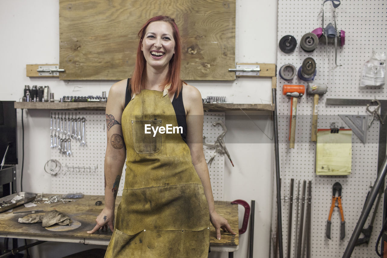 A portrait of a young woman in a dirty apron.