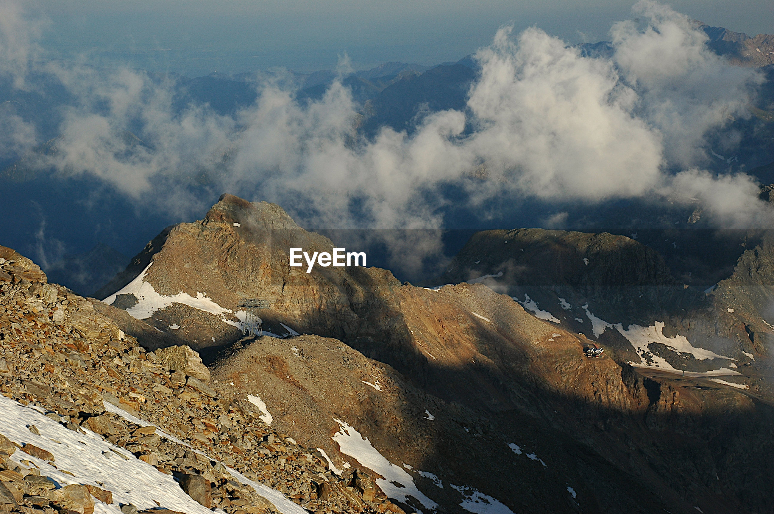Scenic view of mountain range against sky and clouds