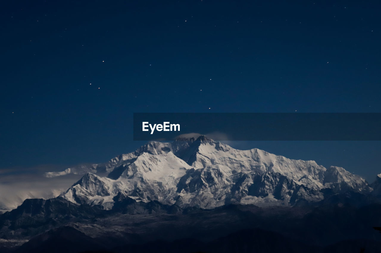 mountain, beauty in nature, sky, scenics - nature, tranquil scene, tranquility, cold temperature, star - space, winter, nature, idyllic, snow, mountain range, space, no people, astronomy, night, non-urban scene, snowcapped mountain, mountain peak, outdoors, iceberg, formation