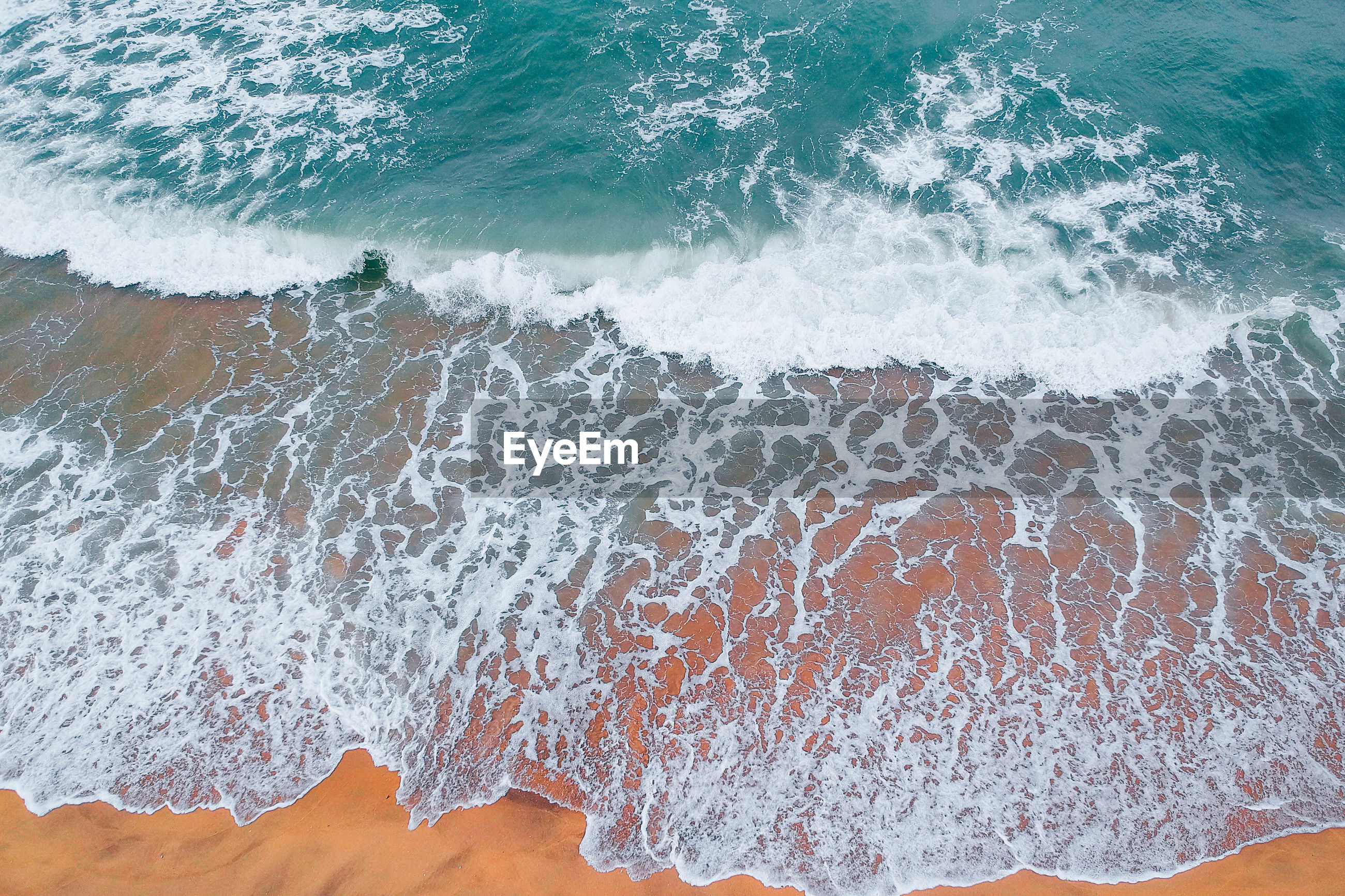 High angle view of surf at beach