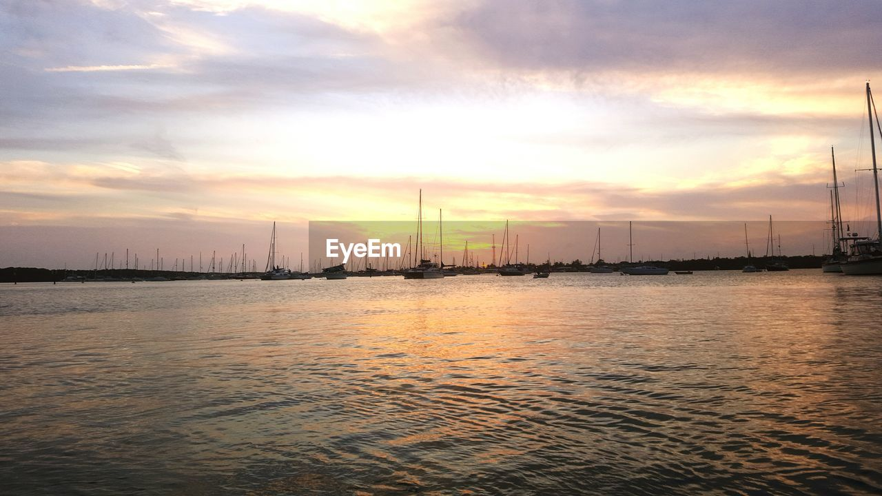 sunset, water, sky, no people, nature, waterfront, sea, cloud - sky, nautical vessel, outdoors, tranquility, industry, beauty in nature, travel destinations, scenics, mast, day