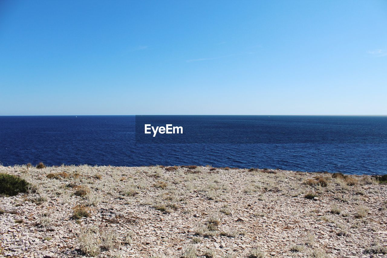 sea, scenics, horizon over water, tranquil scene, nature, water, tranquility, beauty in nature, blue, clear sky, day, outdoors, beach, no people, sky