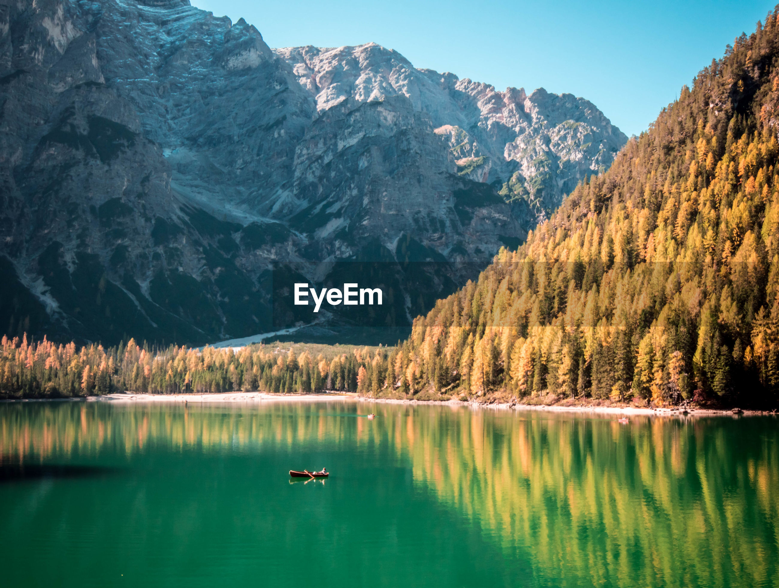 SCENIC VIEW OF CALM LAKE IN FRONT OF MOUNTAINS