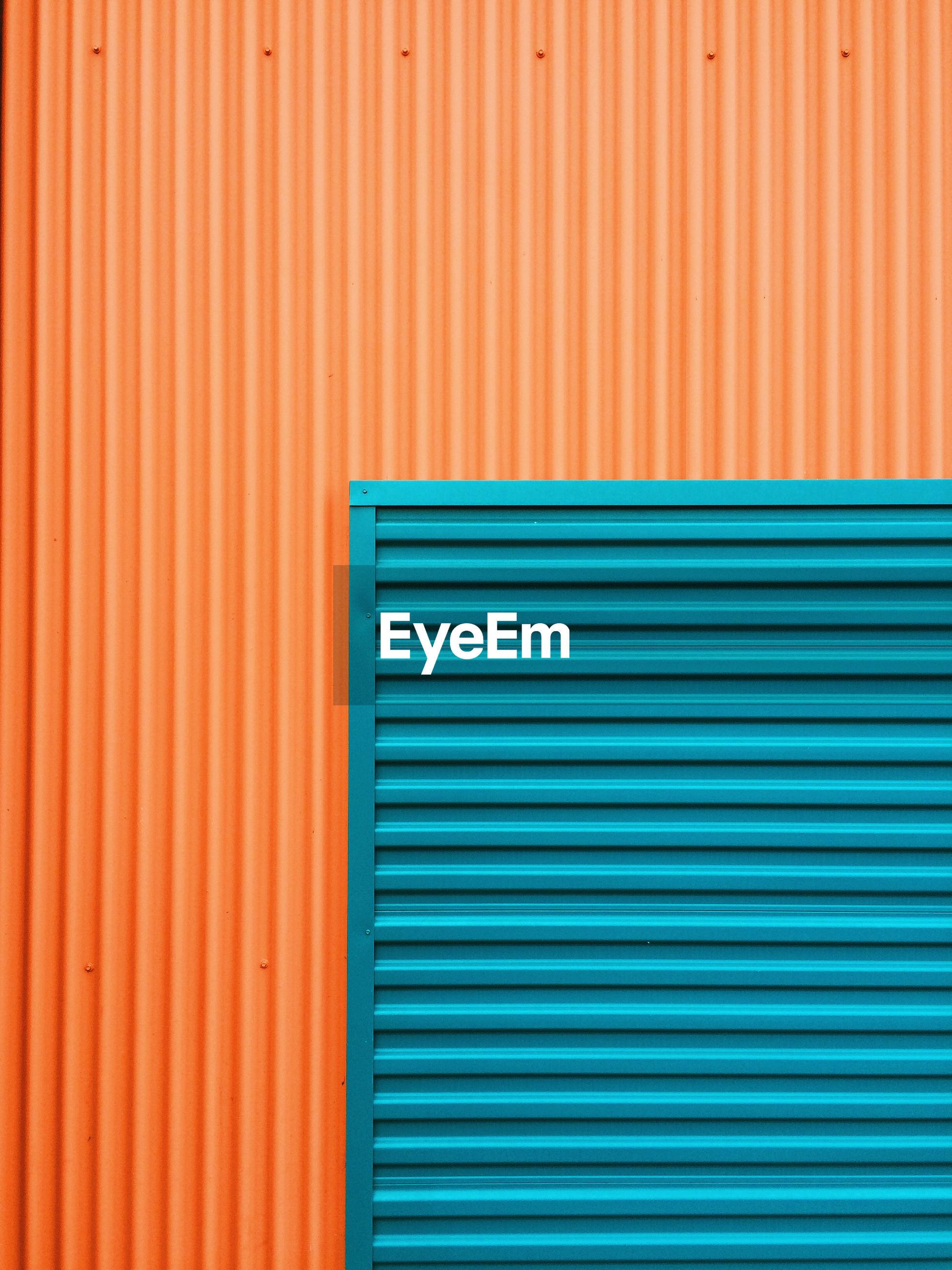 Full frame shot of blue and orange shutter