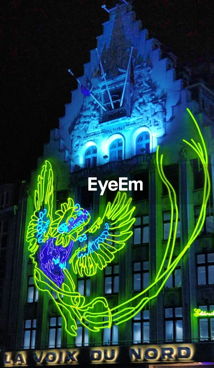 illuminated, night, architecture, animal representation, no people, blue, lighting equipment, neon, glowing, building exterior, built structure, communication, text, representation, light - natural phenomenon, art and craft, motion, outdoors, decoration, animal, neon colored