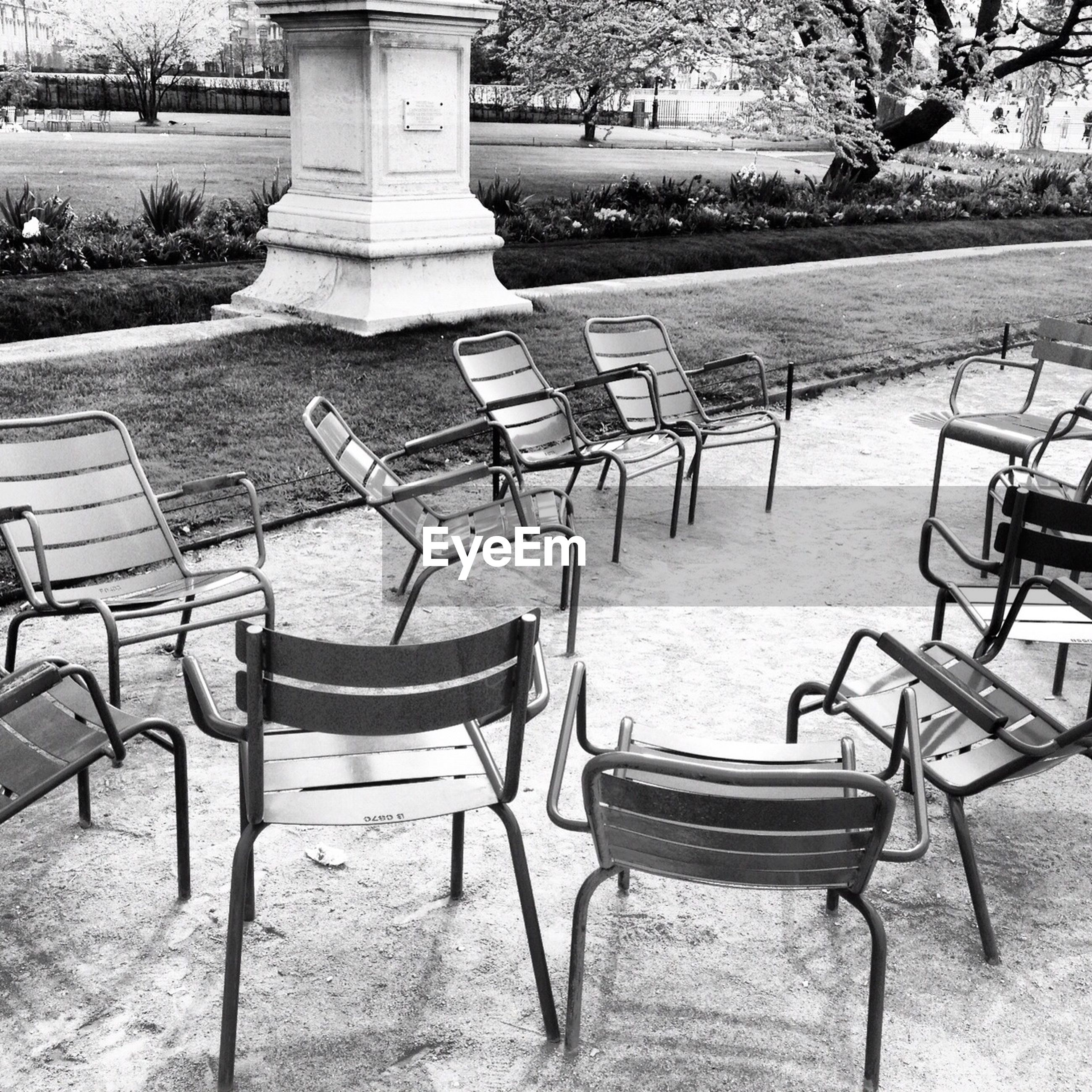 Empty chairs at park