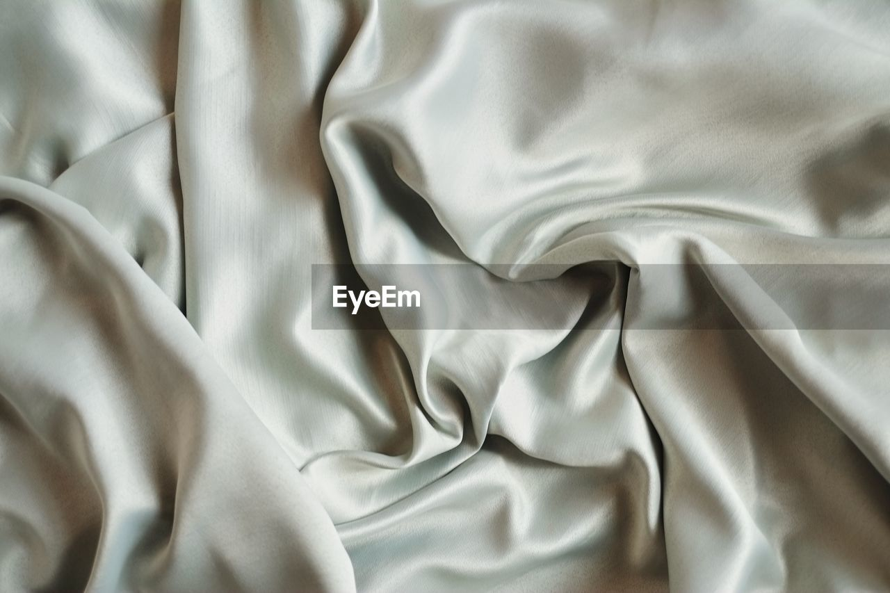 textile, full frame, crumpled, pattern, backgrounds, no people, textured, rippled, indoors, abstract, sheet, wave pattern, linen, wrinkled, bed, softness, close-up, material, white color, shiny, silk, silver colored, luxury