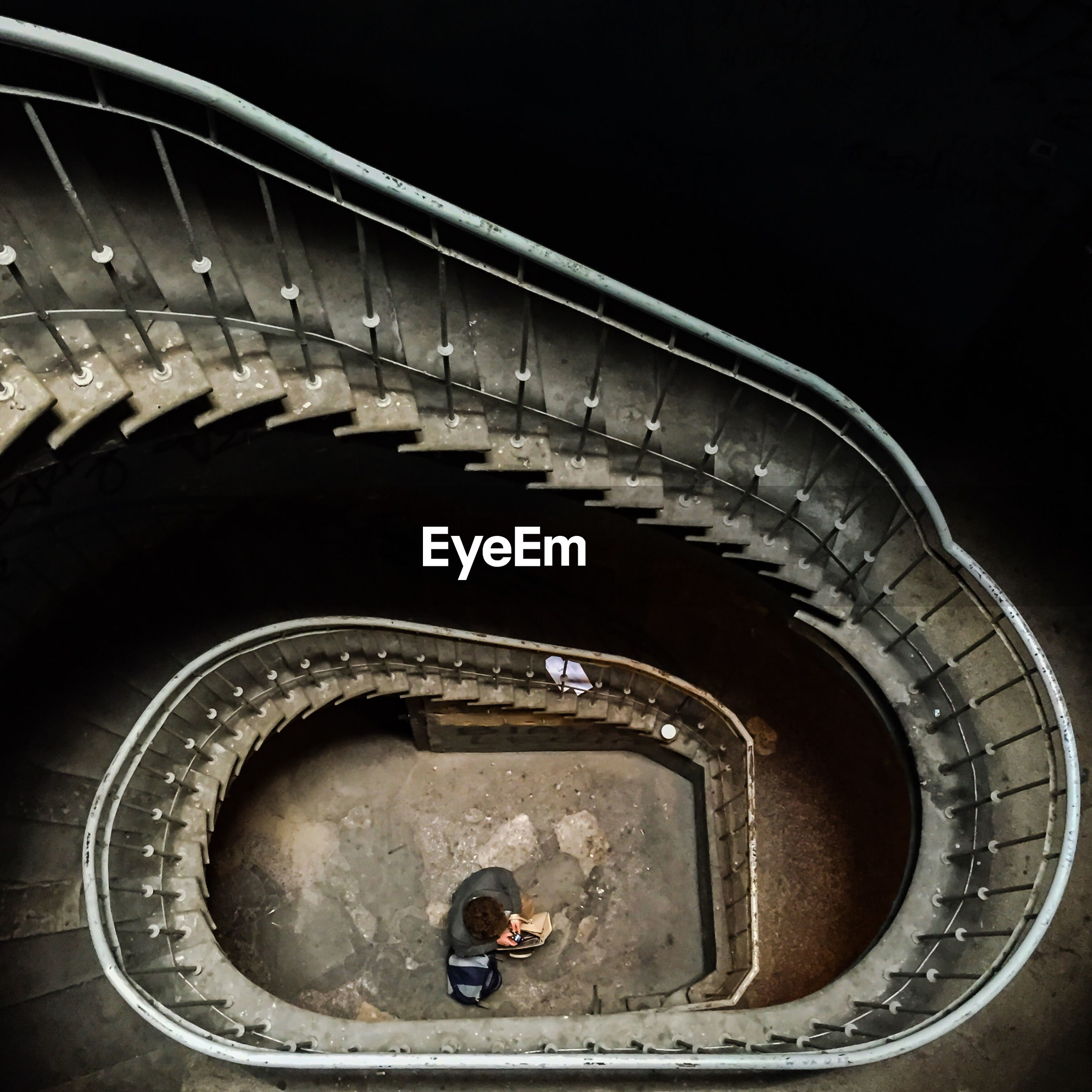 High angle view of spiral staircase with man standing