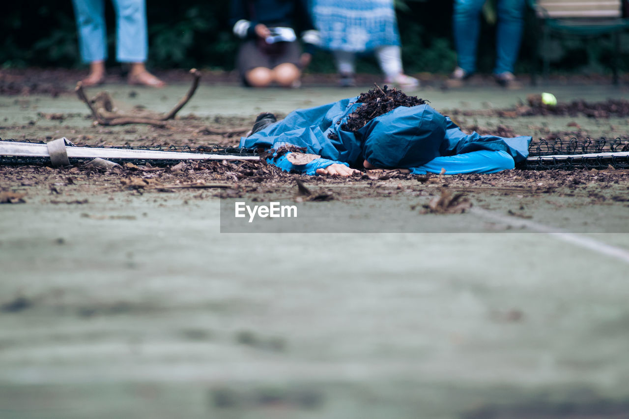 Person lying on playing field