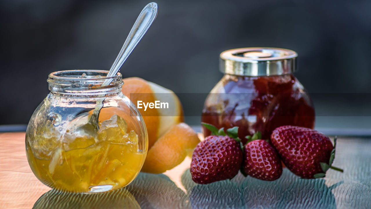 food and drink, food, table, freshness, container, fruit, healthy eating, jar, focus on foreground, close-up, still life, glass - material, wellbeing, no people, berry fruit, transparent, indoors, drink, wood - material, refreshment, lychee