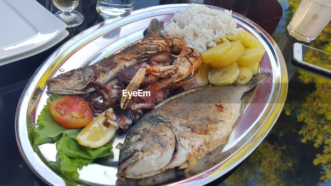 High Angle View Of Fresh Seafood Served In Plate On Table At Restaurant