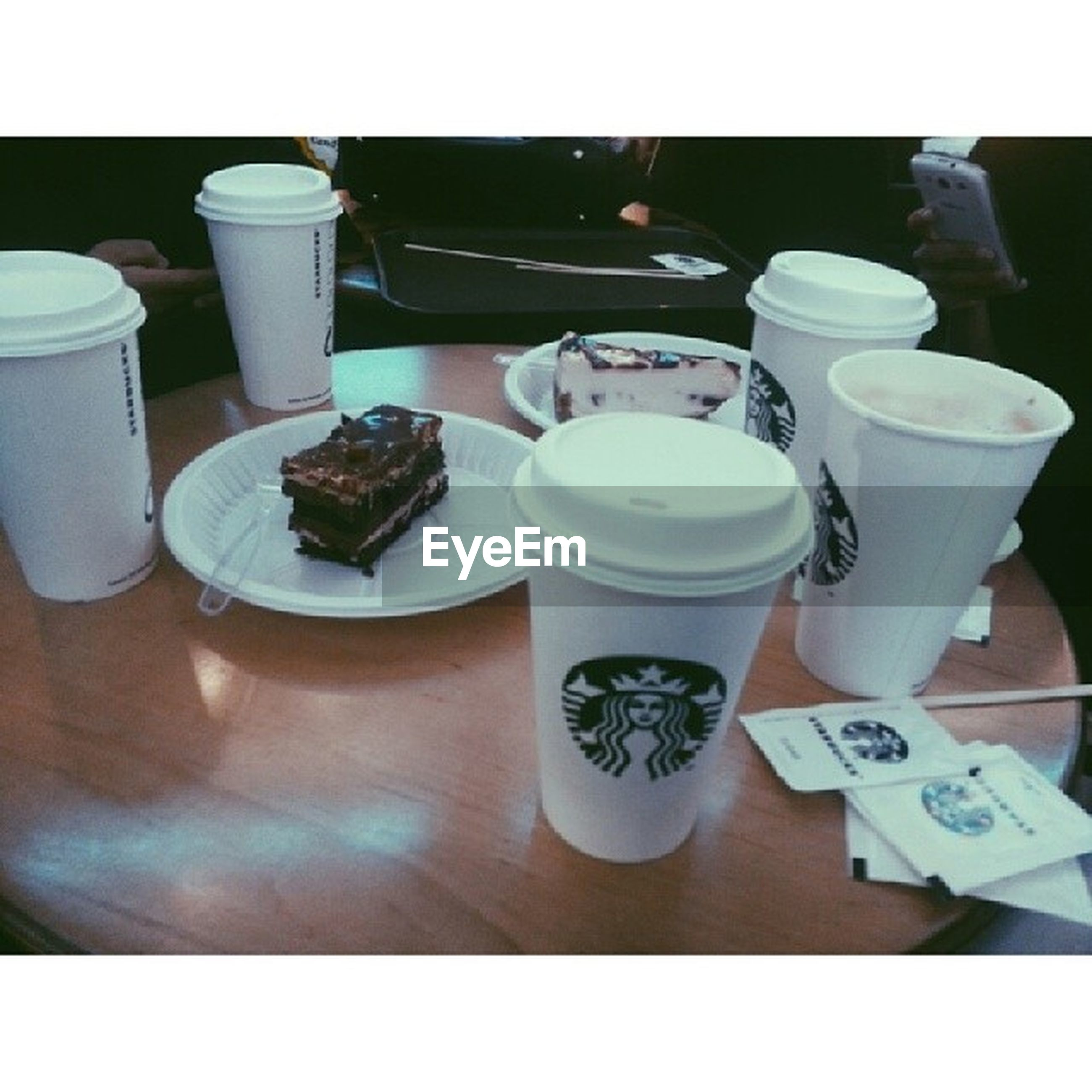 indoors, transfer print, table, food and drink, still life, drink, auto post production filter, freshness, coffee cup, high angle view, refreshment, plate, cup, arrangement, food, close-up, no people, coffee - drink, saucer, large group of objects