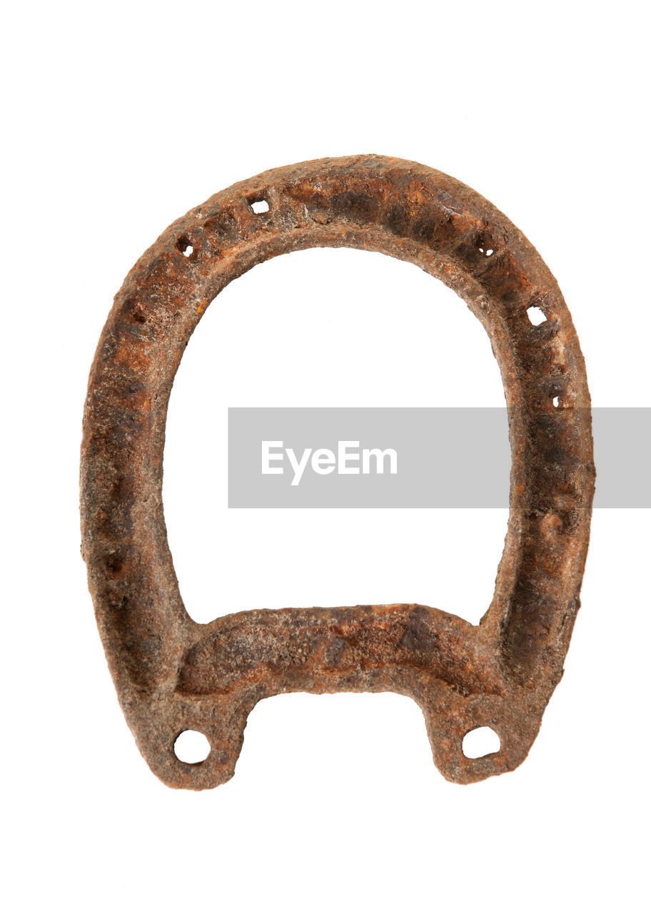 Close-up of rusty metal against white background