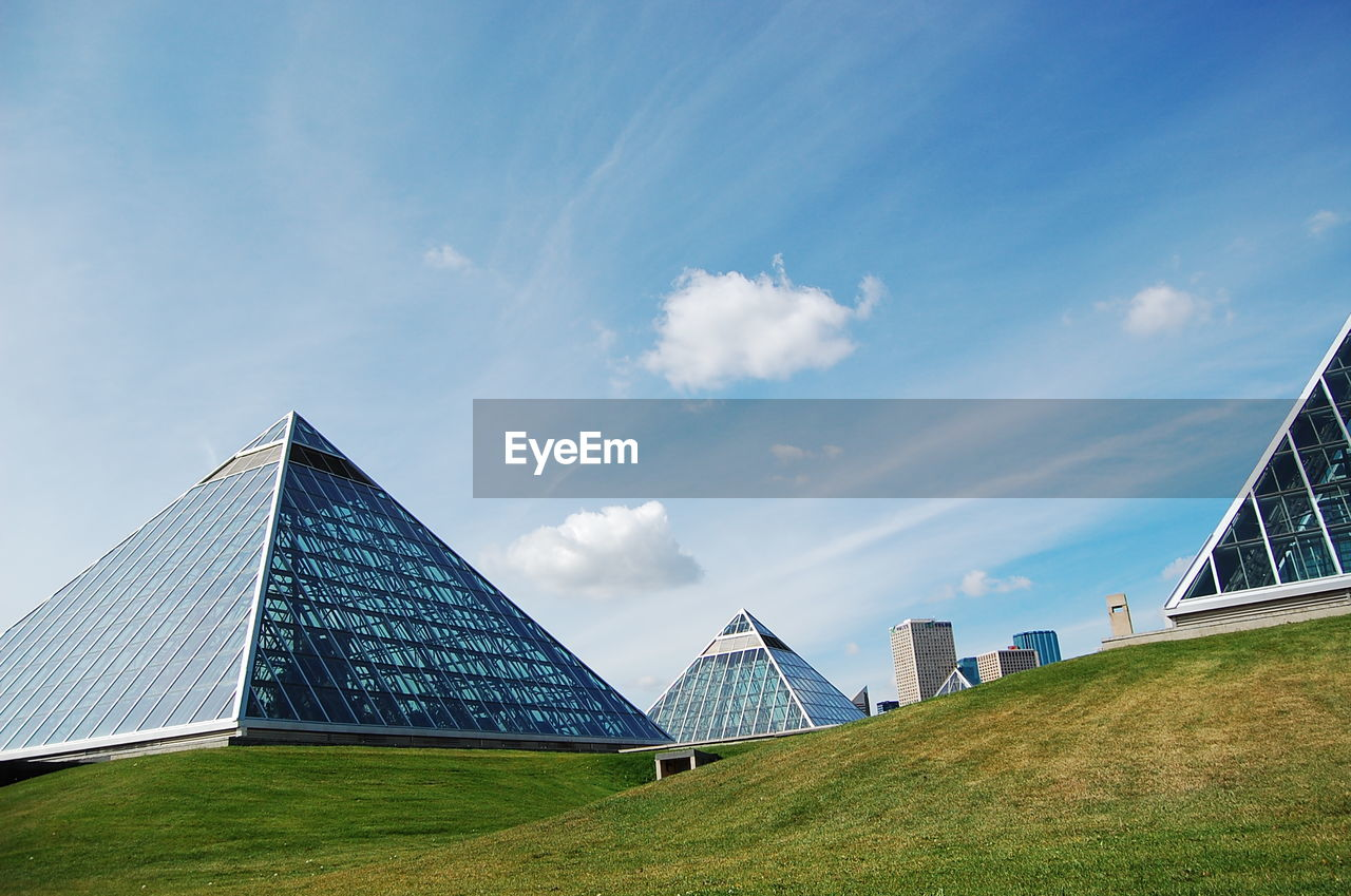 architecture, built structure, travel destinations, sky, tourism, grass, pyramid, travel, day, modern, cloud - sky, outdoors, building exterior, history, nature, no people, city