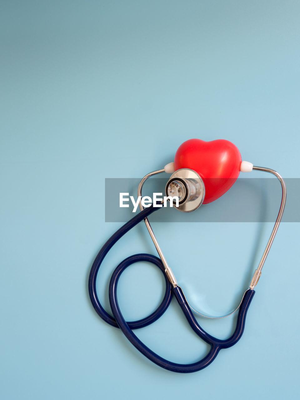 Stethoscope against blue background