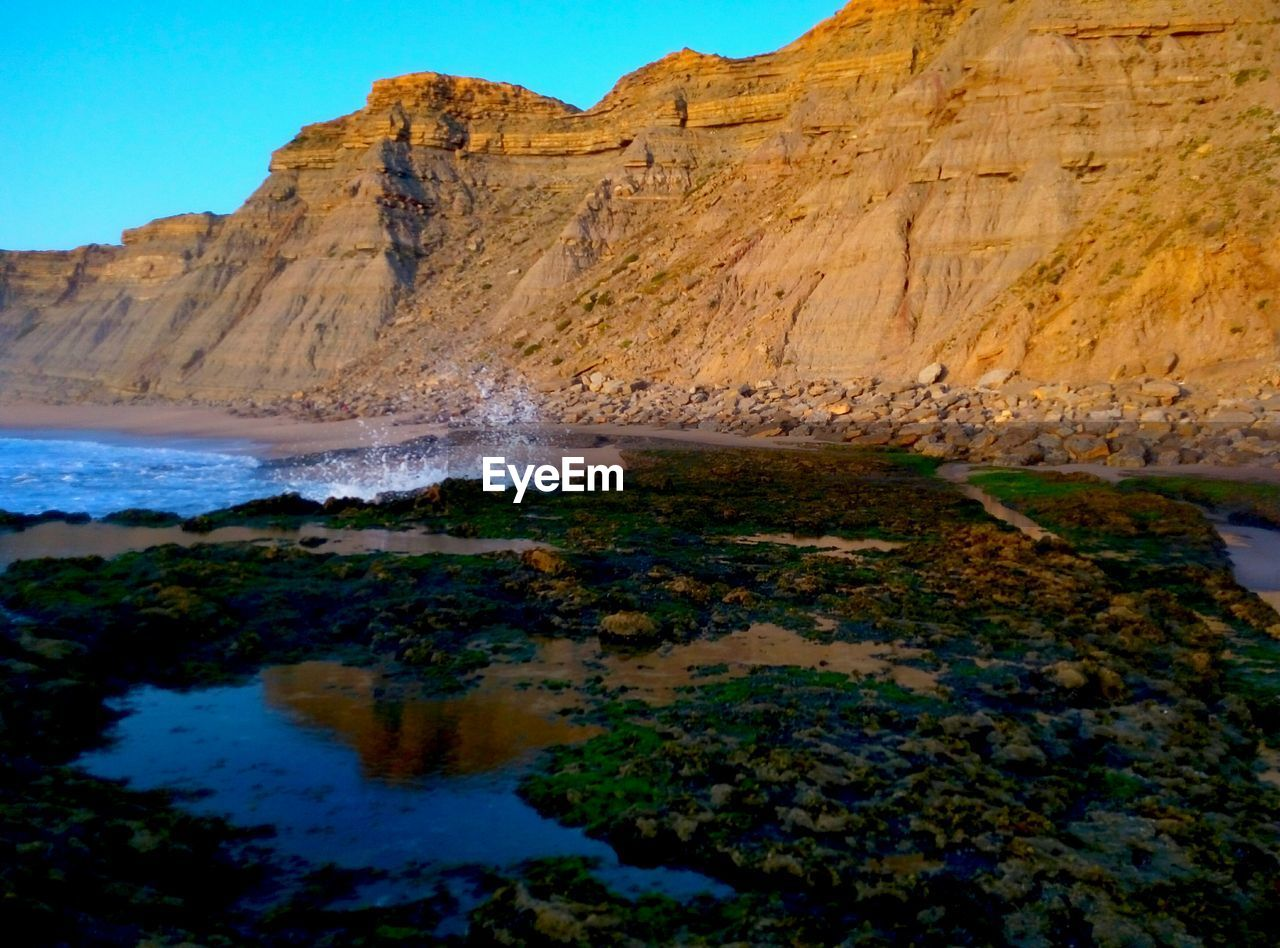 nature, rock formation, rock - object, scenics, no people, day, outdoors, beauty in nature, water, physical geography, sky
