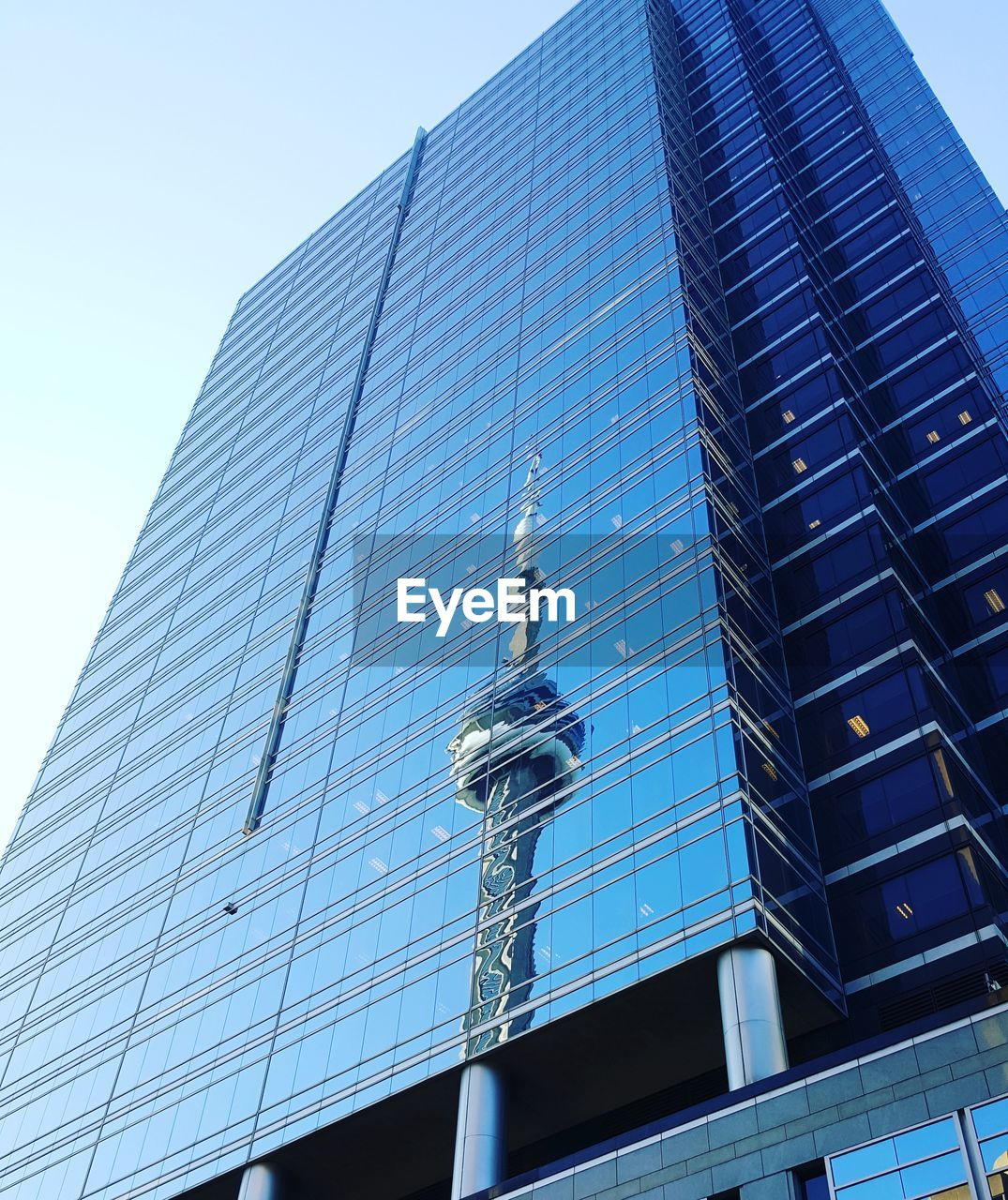 low angle view, architecture, built structure, building exterior, modern, day, no people, outdoors, clear sky, blue, skyscraper, sky, city