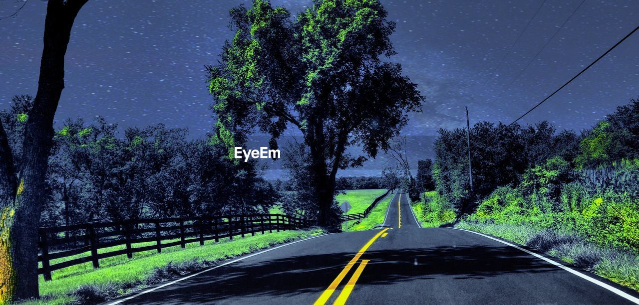tree, road, transportation, plant, symbol, sign, no people, road marking, marking, nature, the way forward, direction, sky, diminishing perspective, double yellow line, night, scenics - nature, car, outdoors, country, dividing line