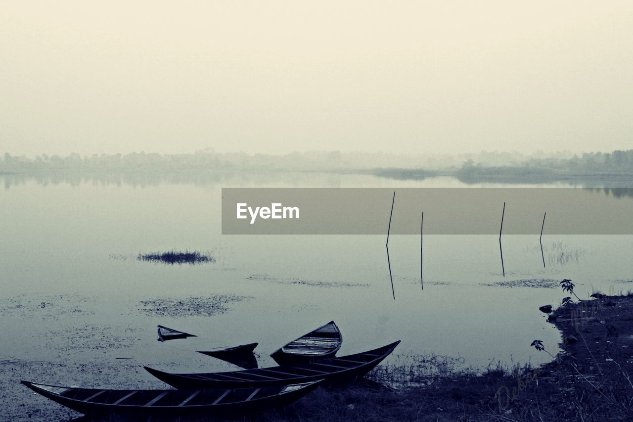 water, nautical vessel, nature, tranquility, lake, outdoors, no people, day, tranquil scene, fog, beauty in nature, scenics, sky