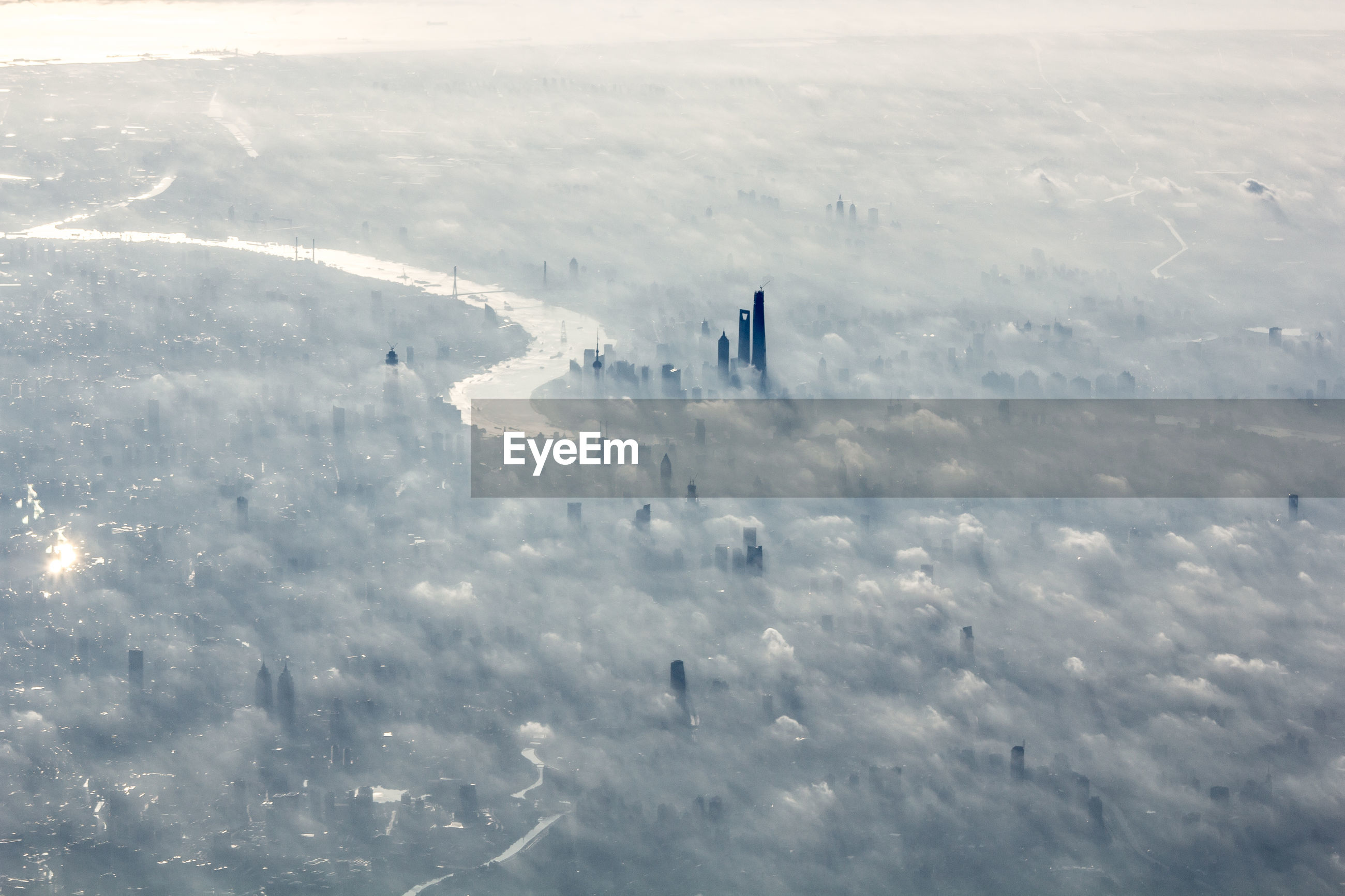 Aerial view of cityscape during foggy weather