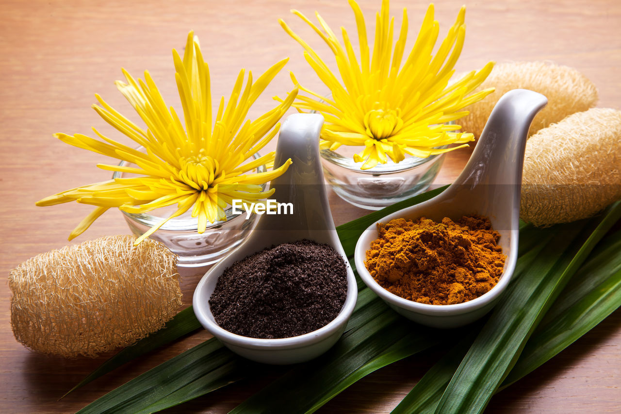 yellow, freshness, food and drink, flower, flowering plant, table, plant, food, close-up, still life, no people, spice, bowl, indoors, variation, choice, beauty in nature, ingredient, container, high angle view, flower head, herb, leaves
