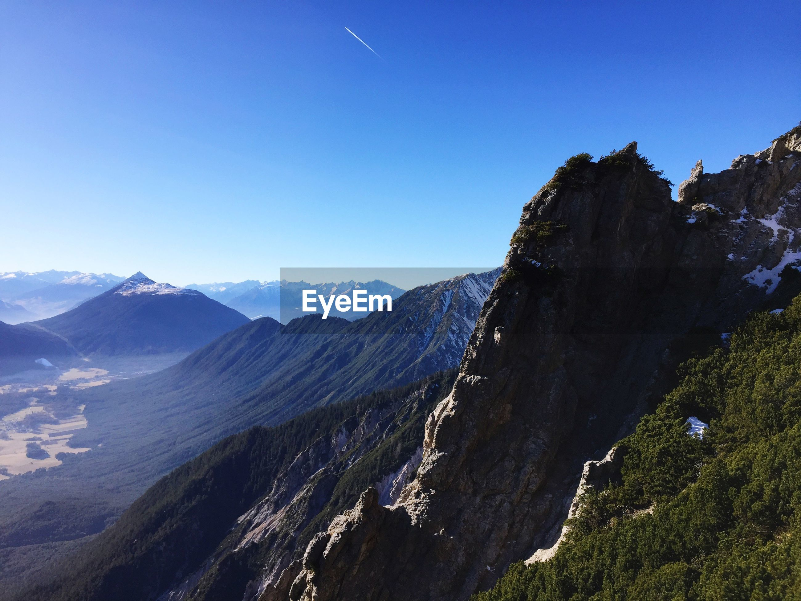 VIEW OF MOUNTAINS AGAINST BLUE SKY