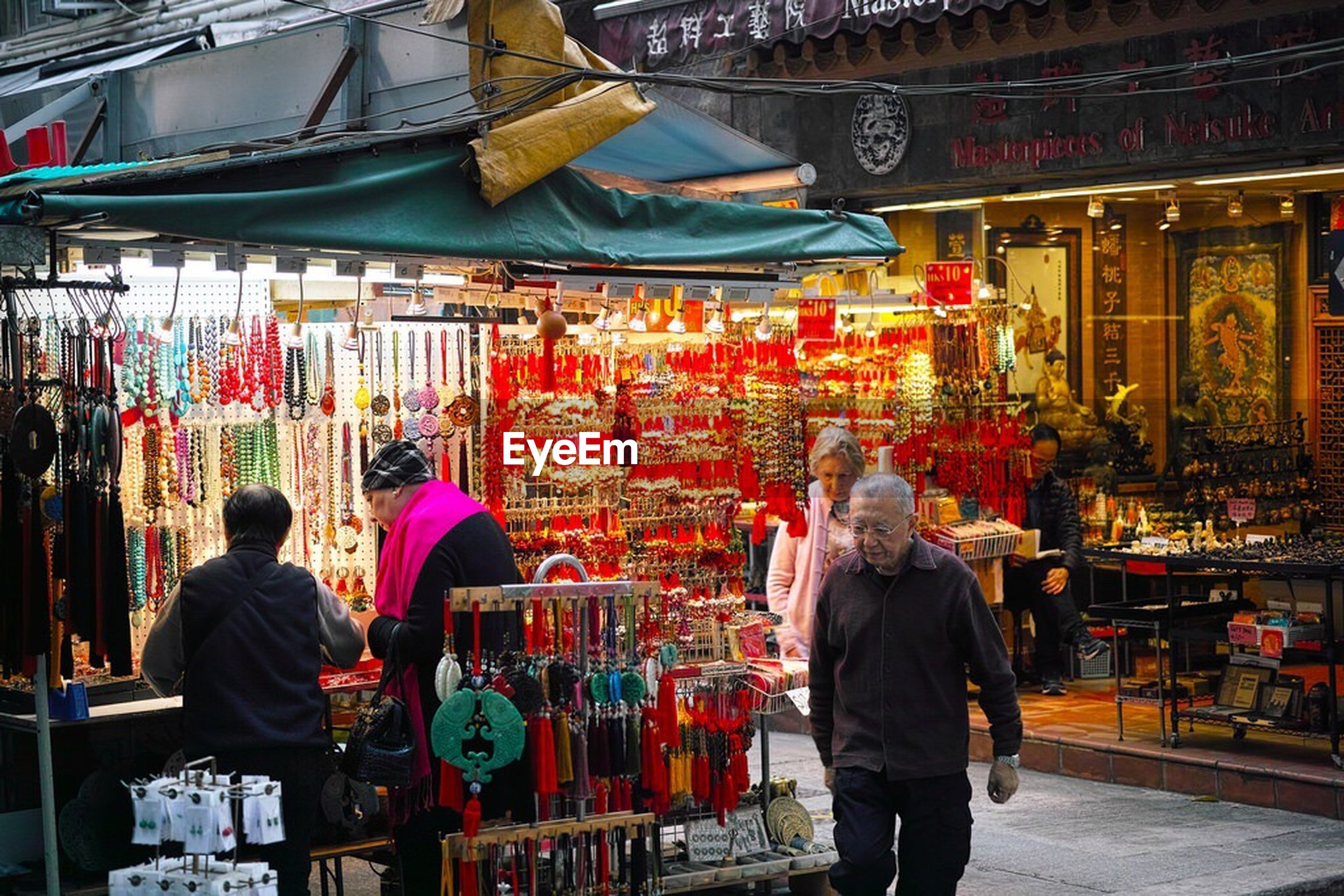 men, lifestyles, person, market, leisure activity, rear view, large group of people, market stall, retail, casual clothing, standing, built structure, cultures, architecture, shopping, for sale, tradition, traditional clothing, hanging