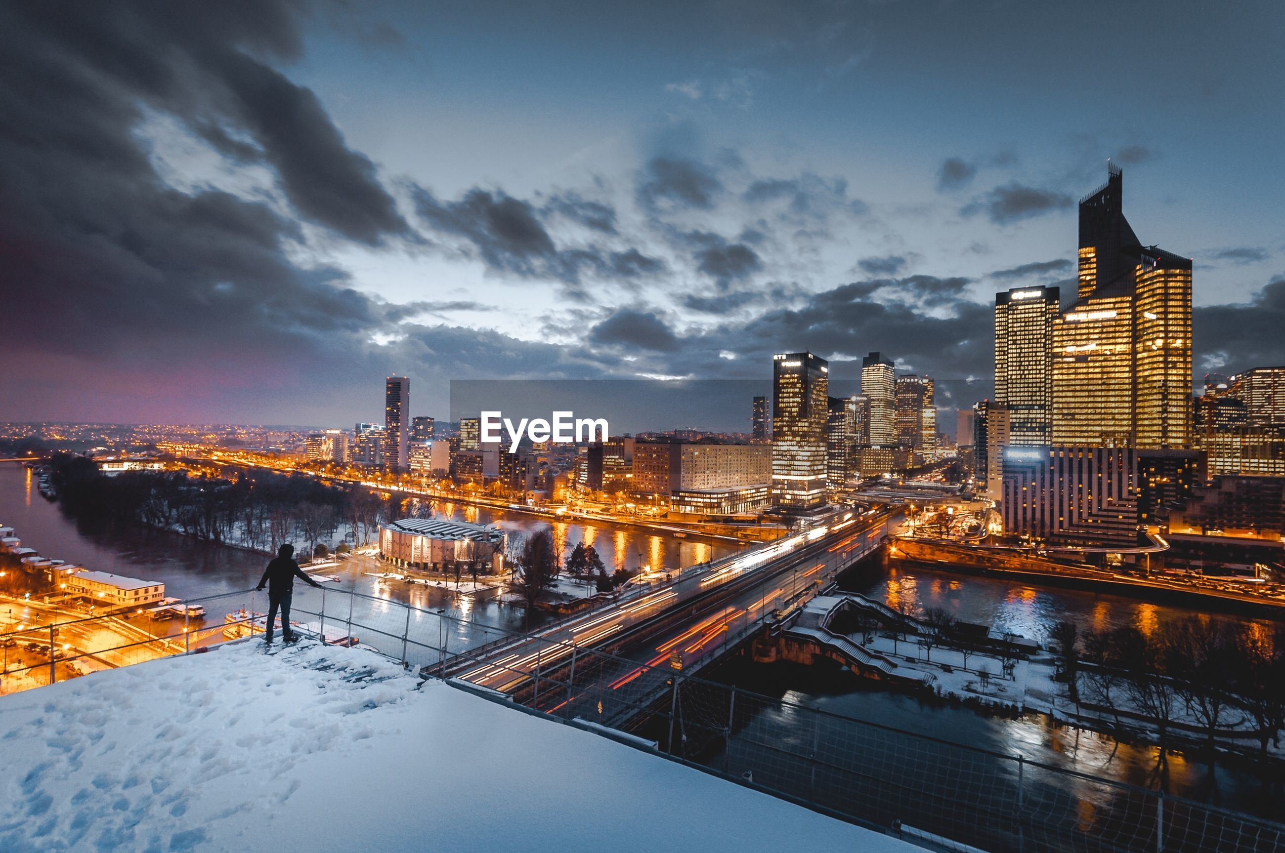 architecture, building exterior, built structure, city, skyscraper, cityscape, sky, tower, cloud - sky, illuminated, cold temperature, travel destinations, city life, snow, outdoors, modern, no people, winter, urban skyline, tall, nature, night, water
