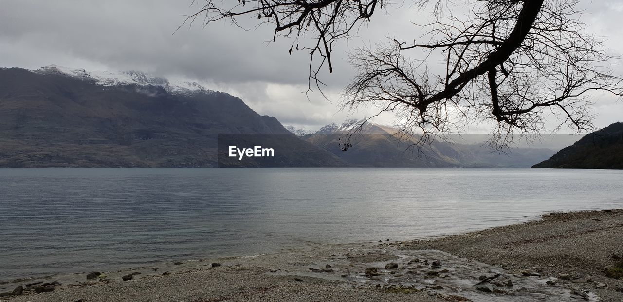 water, sky, mountain, beauty in nature, tranquility, scenics - nature, tranquil scene, nature, cloud - sky, no people, fog, lake, environment, non-urban scene, land, landscape, day, outdoors