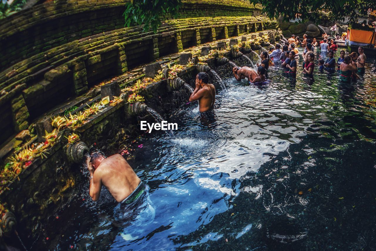 water, real people, group of people, lifestyles, leisure activity, men, nature, waterfront, crowd, day, large group of people, women, enjoyment, adult, motion, swimming, outdoors, trip