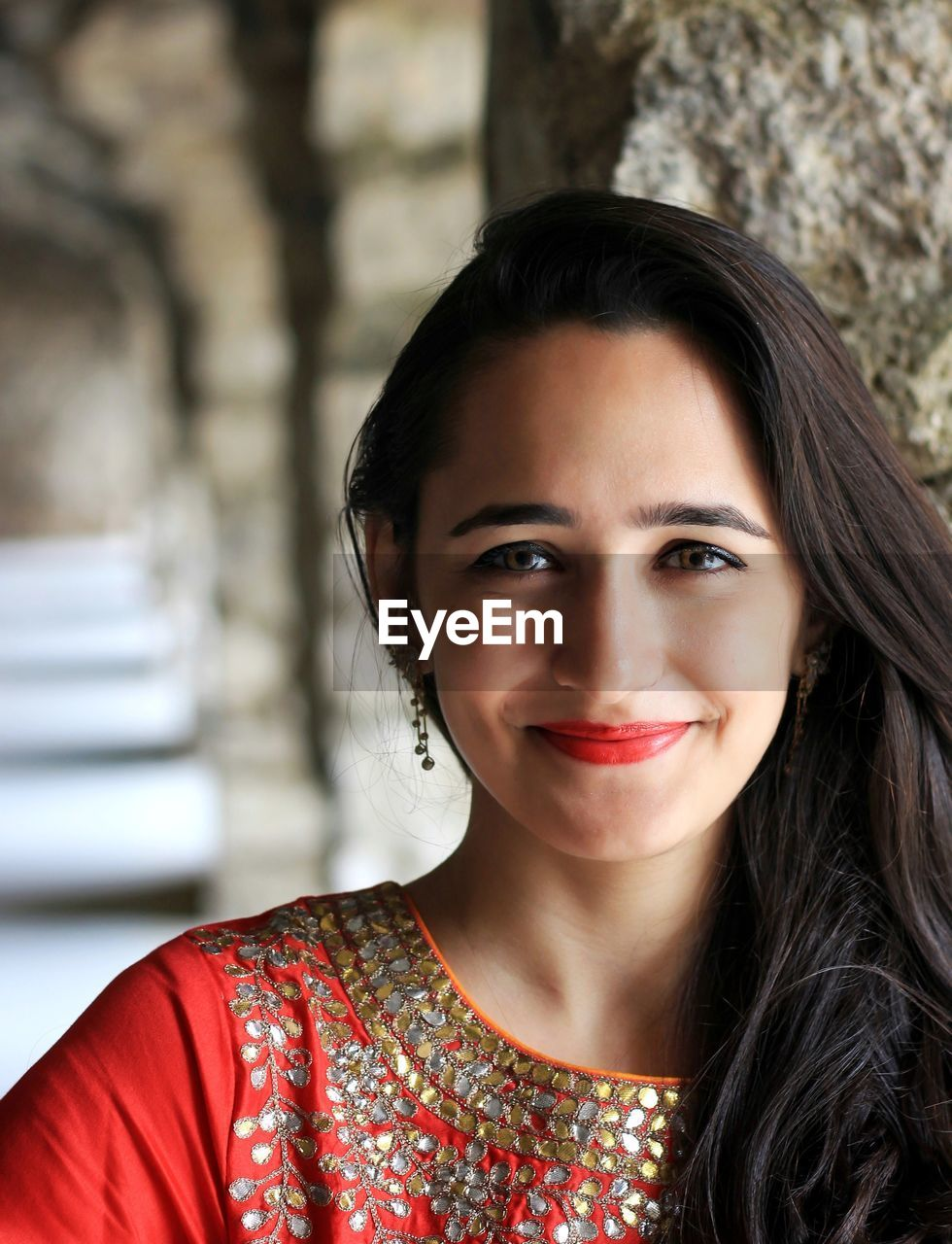 portrait, looking at camera, smiling, young adult, headshot, one person, young women, focus on foreground, real people, front view, black hair, leisure activity, hair, beauty, lifestyles, beautiful woman, women, happiness, adult, hairstyle
