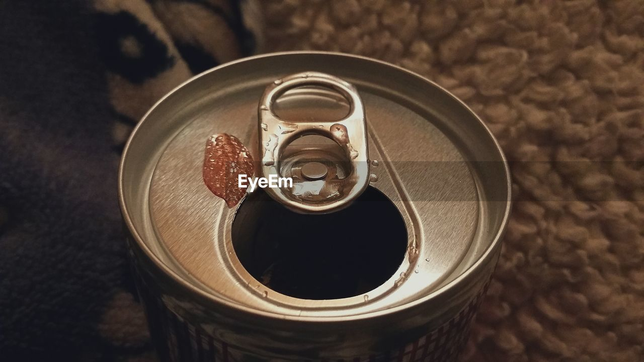 Close-up of open beer drink can